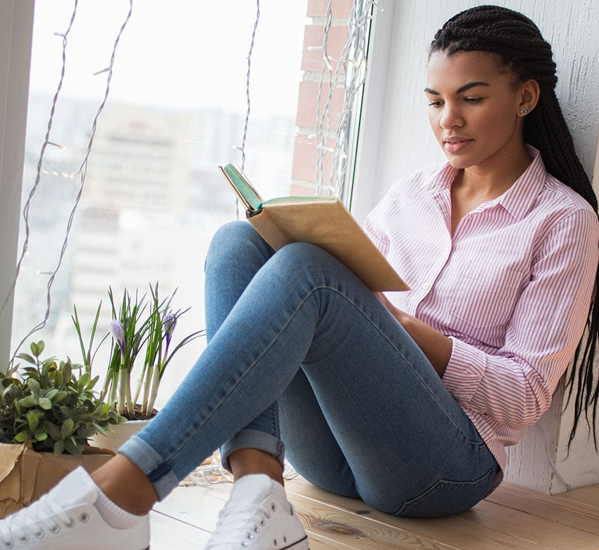 Woman sitting down  reading book