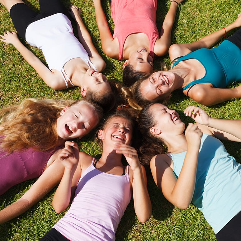 Laughing group of girls protected by chlorine free pads